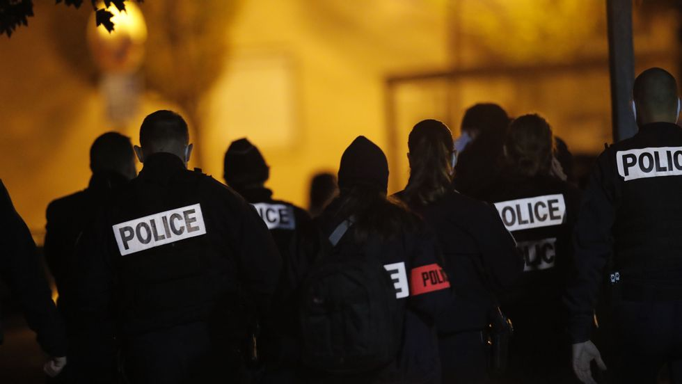 A large police rally gathered outside the school where a history teacher who had shown Muhammad caricatures in teaching about freedom of expression, was stabbed to death on Friday. A suspected perpetrator was shot and killed by police. Photo: Michel Euler / AP